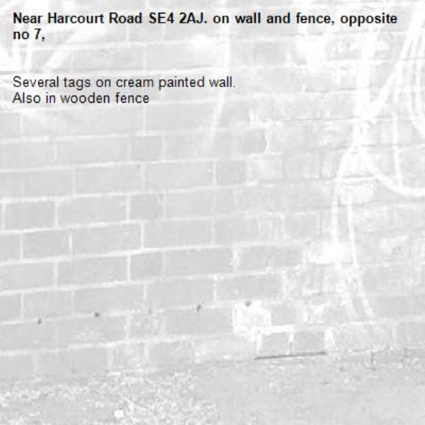 Several tags on cream painted wall. Also in wooden fence-Harcourt Road SE4 2AJ. on wall and fence, opposite no 7,