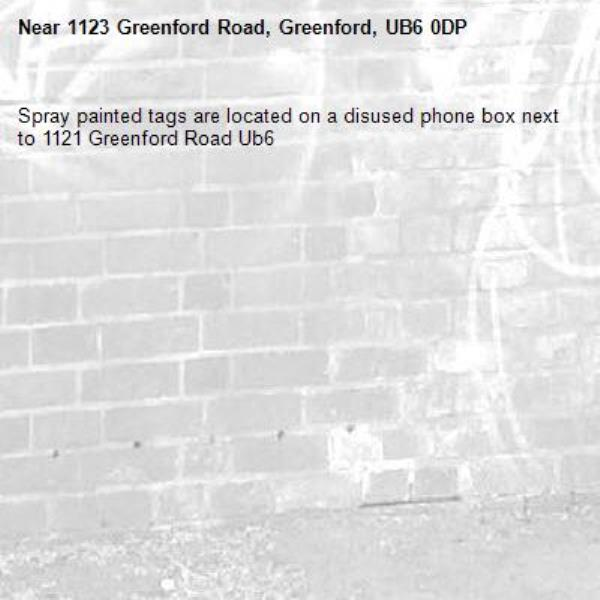 Spray painted tags are located on a disused phone box next to 1121 Greenford Road Ub6 -1123 Greenford Road, Greenford, UB6 0DP