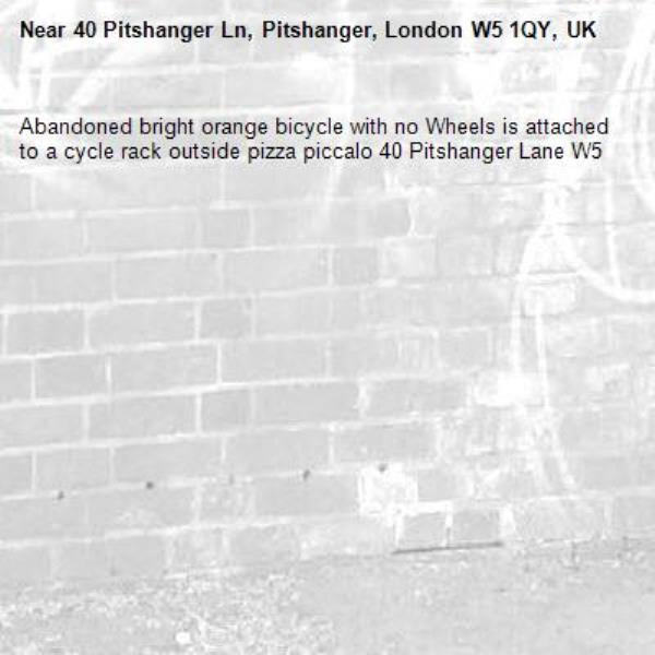 Abandoned bright orange bicycle with no Wheels is attached to a cycle rack outside pizza piccalo 40 Pitshanger Lane W5 -40 Pitshanger Ln, Pitshanger, London W5 1QY, UK