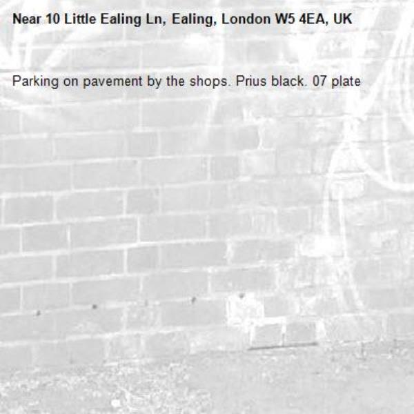 Parking on pavement by the shops. Prius black. 07 plate-10 Little Ealing Ln, Ealing, London W5 4EA, UK