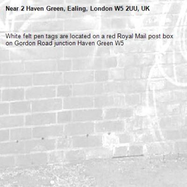White felt pen tags are located on a red Royal Mail post box on Gordon Road junction Haven Green W5 -2 Haven Green, Ealing, London W5 2UU, UK