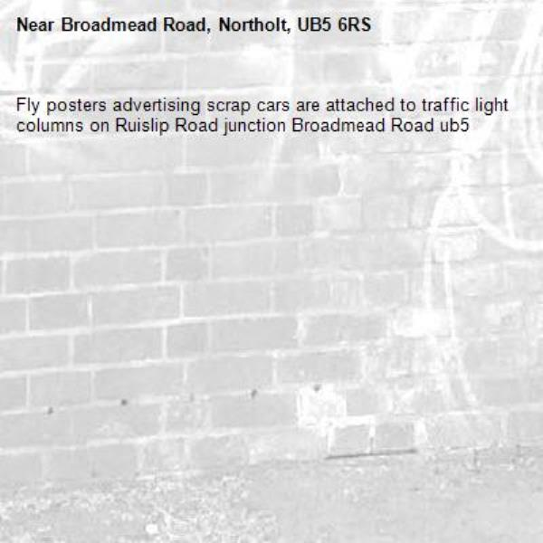 Fly posters advertising scrap cars are attached to traffic light columns on Ruislip Road junction Broadmead Road ub5 -Broadmead Road, Northolt, UB5 6RS