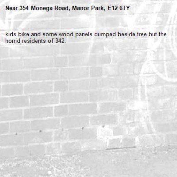kids bike and some wood panels dumped beside tree but the horrid residents of 342.-354 Monega Road, Manor Park, E12 6TY