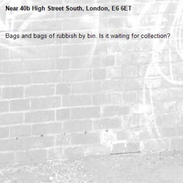 Bags and bags of rubbish by bin. Is it waiting for collection?-40b High Street South, London, E6 6ET