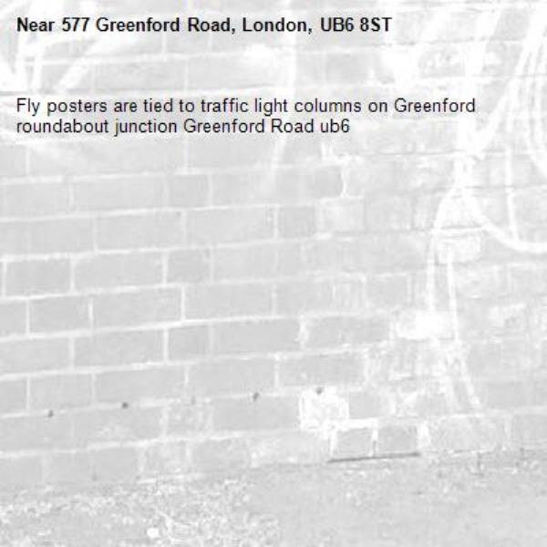 Fly posters are tied to traffic light columns on Greenford roundabout junction Greenford Road ub6 -577 Greenford Road, London, UB6 8ST