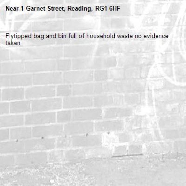 Flytipped bag and bin full of household waste no evidence taken -1 Garnet Street, Reading, RG1 6HF