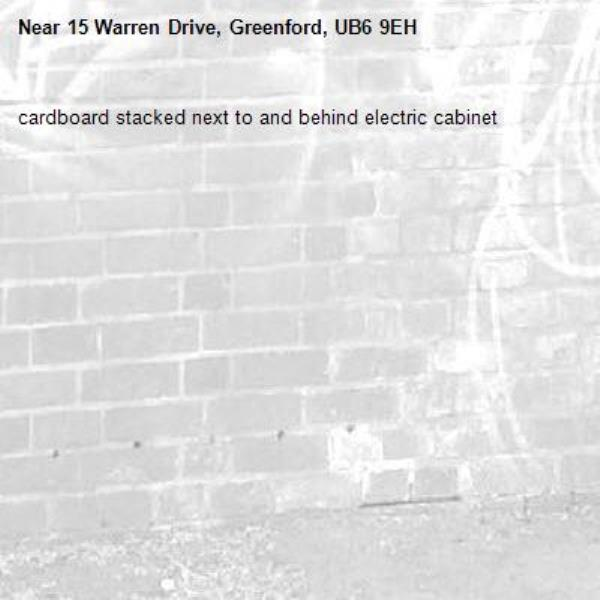 cardboard stacked next to and behind electric cabinet -15 Warren Drive, Greenford, UB6 9EH