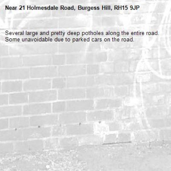 Several large and pretty deep potholes along the entire road. Some unavoidable due to parked cars on the road.-21 Holmesdale Road, Burgess Hill, RH15 9JP