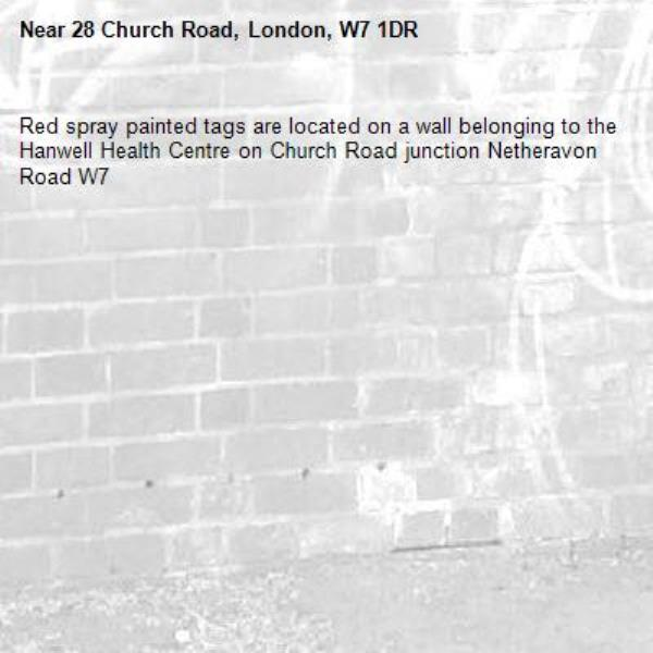 Red spray painted tags are located on a wall belonging to the Hanwell Health Centre on Church Road junction Netheravon Road W7-28 Church Road, London, W7 1DR