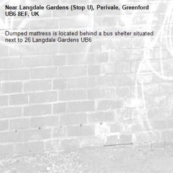 Dumped mattress is located behind a bus shelter situated next to 26 Langdale Gardens UB6 -Langdale Gardens (Stop U), Perivale, Greenford UB6 8EF, UK