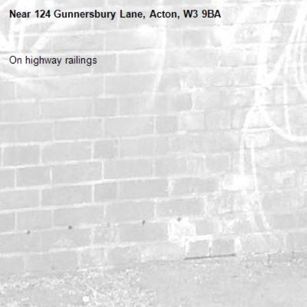 On highway railings-124 Gunnersbury Lane, Acton, W3 9BA