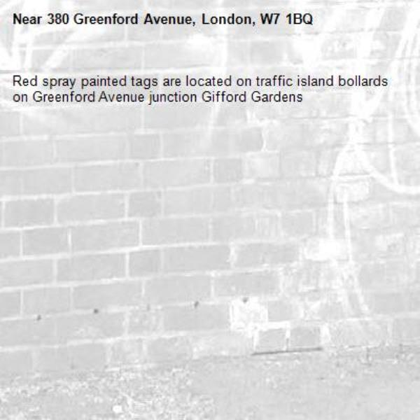 Red spray painted tags are located on traffic island bollards on Greenford Avenue junction Gifford Gardens -380 Greenford Avenue, London, W7 1BQ