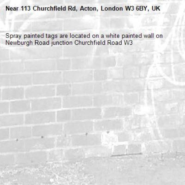 Spray painted tags are located on a white painted wall on Newburgh Road junction Churchfield Road W3-113 Churchfield Rd, Acton, London W3 6BY, UK