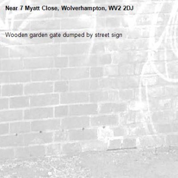 Wooden garden gate dumped by street sign-7 Myatt Close, Wolverhampton, WV2 2DJ