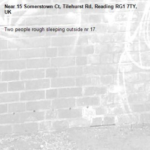 Two people rough sleeping outside nr 17.-15 Somerstown Ct, Tilehurst Rd, Reading RG1 7TY, UK
