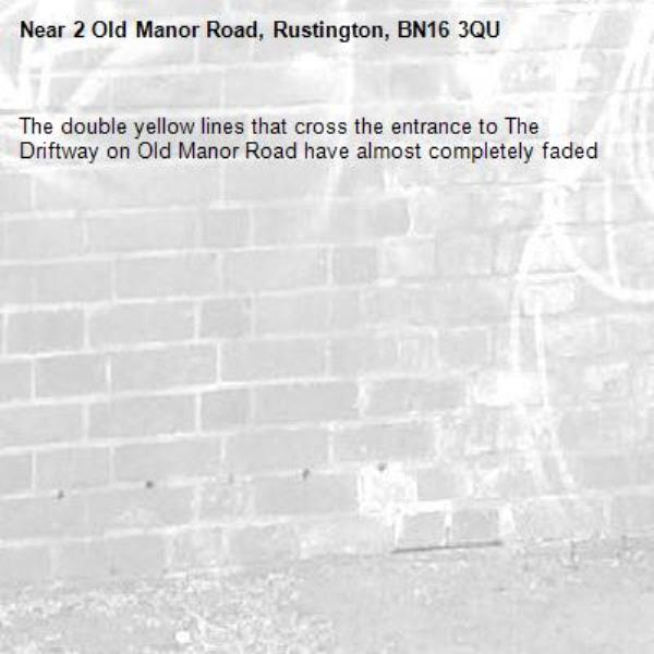 The double yellow lines that cross the entrance to The Driftway on Old Manor Road have almost completely faded-2 Old Manor Road, Rustington, BN16 3QU