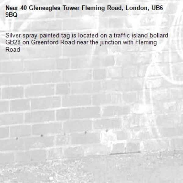 Silver spray painted tag is located on a traffic island bollard GB28 on Greenford Road near the junction with Fleming Road -40 Gleneagles Tower Fleming Road, London, UB6 9BQ
