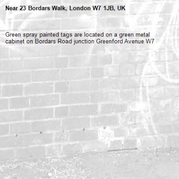 Green spray painted tags are located on a green metal cabinet on Bordars Road junction Greenford Avenue W7 -23 Bordars Walk, London W7 1JB, UK