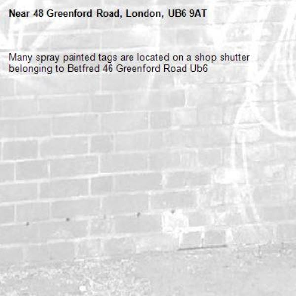 Many spray painted tags are located on a shop shutter belonging to Betfred 46 Greenford Road Ub6 -48 Greenford Road, London, UB6 9AT