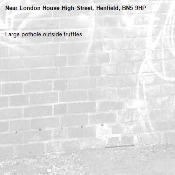 Large pothole outside truffles-London House High Street, Henfield, BN5 9HP