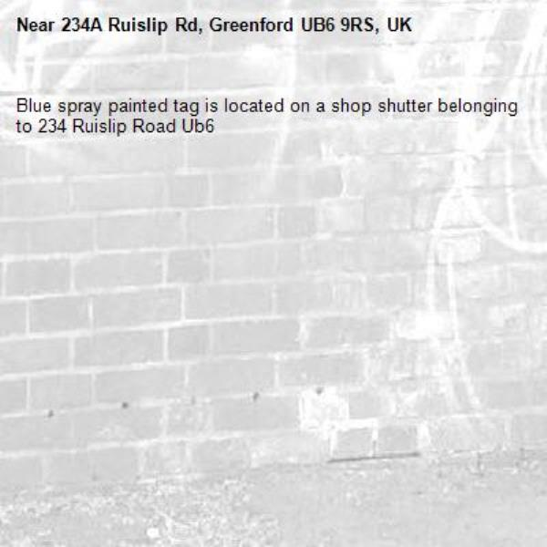 Blue spray painted tag is located on a shop shutter belonging to 234 Ruislip Road Ub6 -234A Ruislip Rd, Greenford UB6 9RS, UK