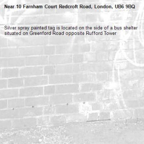 Silver spray painted tag is located on the side of a bus shelter situated on Greenford Road opposite Rufford Tower -10 Farnham Court Redcroft Road, London, UB6 9BQ