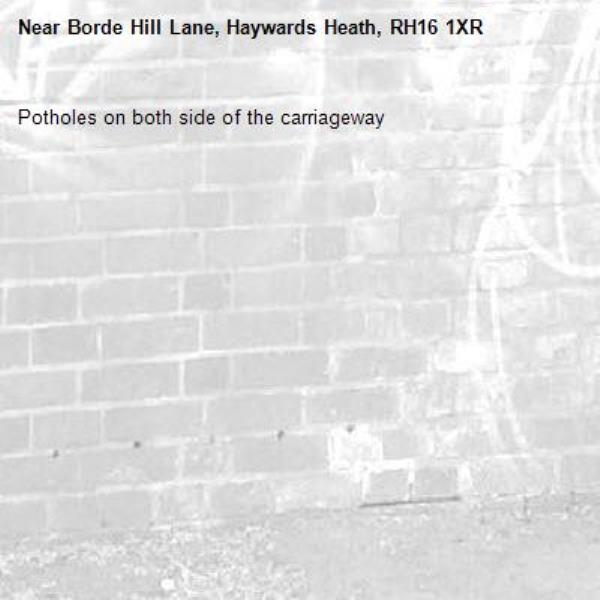 Potholes on both side of the carriageway-Borde Hill Lane, Haywards Heath, RH16 1XR