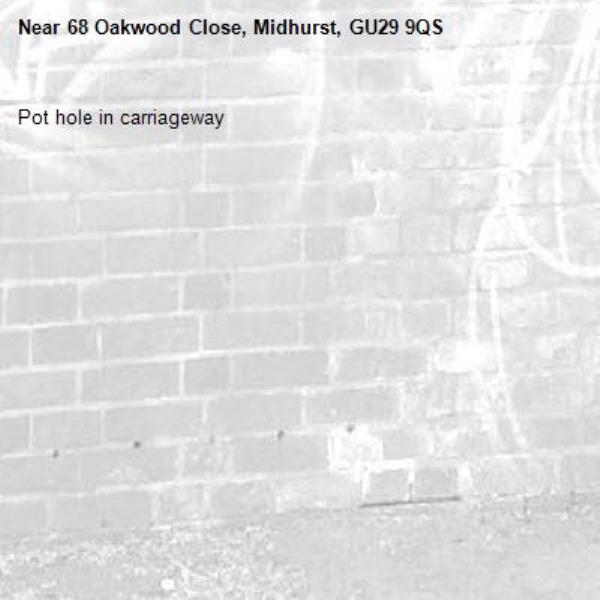 Pot hole in carriageway -68 Oakwood Close, Midhurst, GU29 9QS