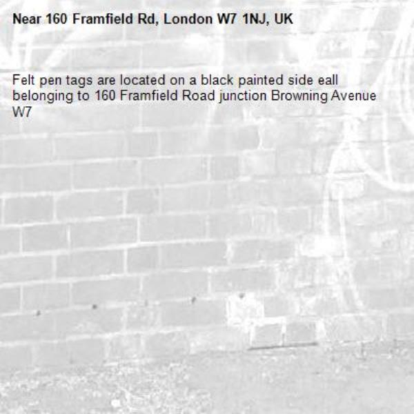 Felt pen tags are located on a black painted side eall belonging to 160 Framfield Road junction Browning Avenue W7 -160 Framfield Rd, London W7 1NJ, UK