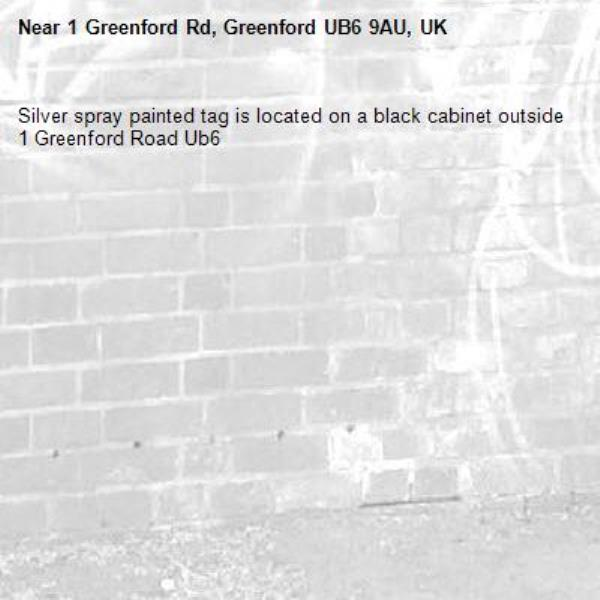 Silver spray painted tag is located on a black cabinet outside 1 Greenford Road Ub6 -1 Greenford Rd, Greenford UB6 9AU, UK