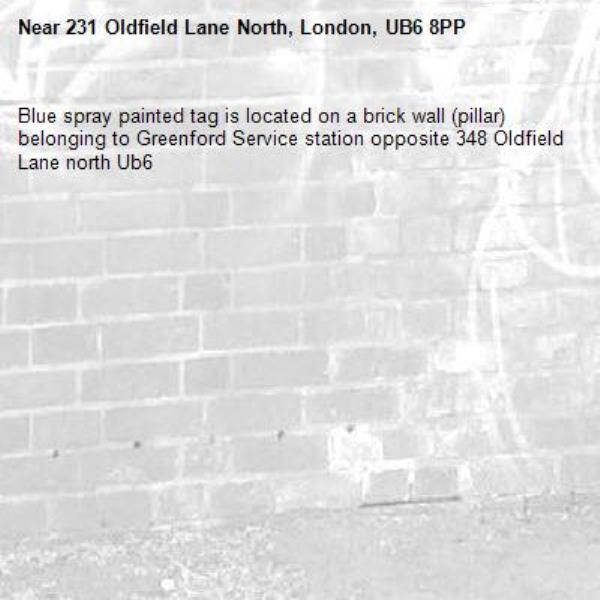 Blue spray painted tag is located on a brick wall (pillar) belonging to Greenford Service station opposite 348 Oldfield Lane north Ub6 -231 Oldfield Lane North, London, UB6 8PP