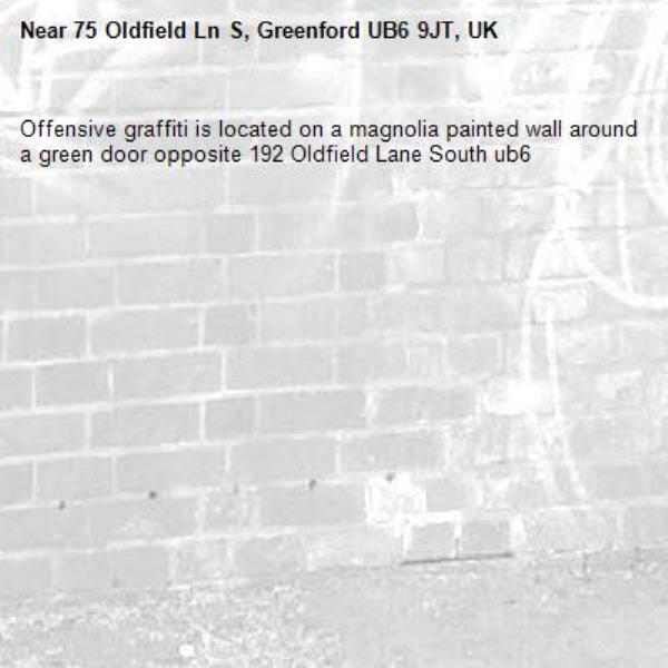 Offensive graffiti is located on a magnolia painted wall around a green door opposite 192 Oldfield Lane South ub6 -75 Oldfield Ln S, Greenford UB6 9JT, UK