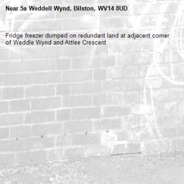 Fridge freezer dumped on redundant land at adjacent corner of Weddle Wynd and Attlee Crescent -5a Weddell Wynd, Bilston, WV14 8UD