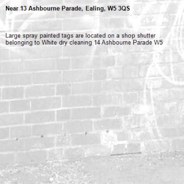 Large spray painted tags are located on a shop shutter belonging to White dry cleaning 14 Ashbourne Parade W5 -13 Ashbourne Parade, Ealing, W5 3QS