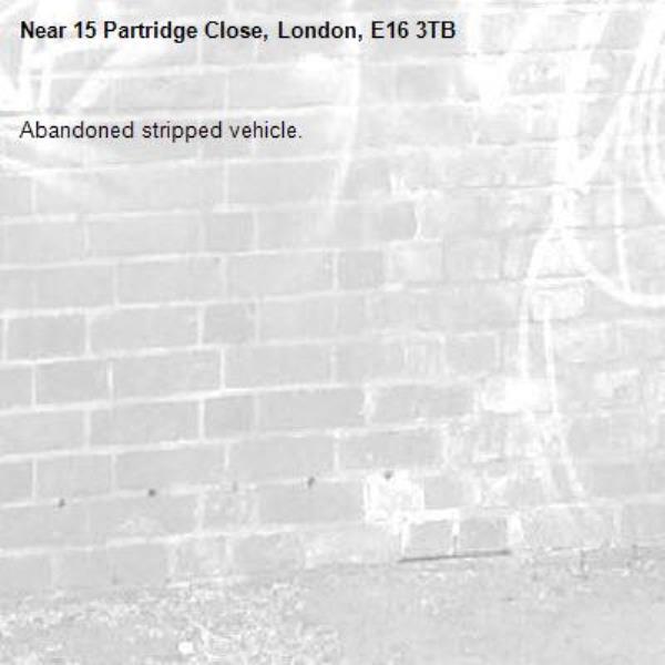 Abandoned stripped vehicle.-15 Partridge Close, London, E16 3TB