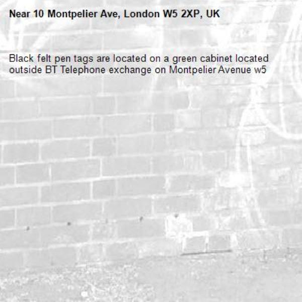 Black felt pen tags are located on a green cabinet located outside BT Telephone exchange on Montpelier Avenue w5-10 Montpelier Ave, London W5 2XP, UK