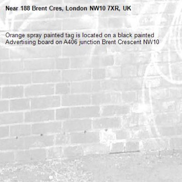 Orange spray painted tag is located on a black painted Advertising board on A406 junction Brent Crescent NW10-188 Brent Cres, London NW10 7XR, UK