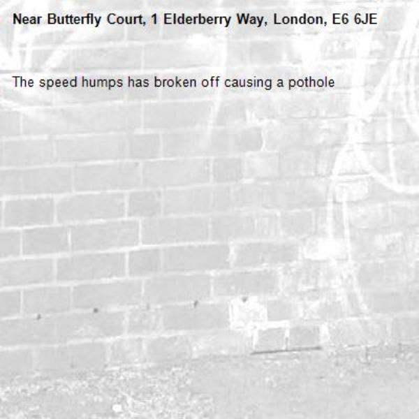 The speed humps has broken off causing a pothole-Butterfly Court, 1 Elderberry Way, London, E6 6JE