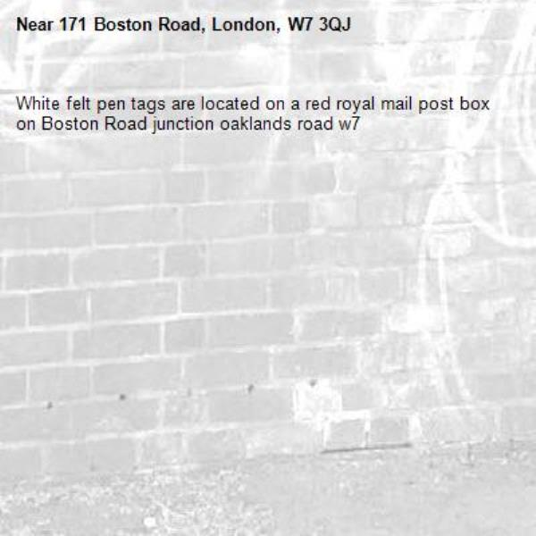 White felt pen tags are located on a red royal mail post box on Boston Road junction oaklands road w7-171 Boston Road, London, W7 3QJ
