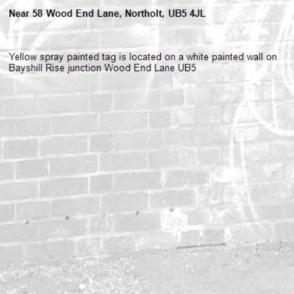 Yellow spray painted tag is located on a white painted wall on Bayshill Rise junction Wood End Lane UB5 -58 Wood End Lane, Northolt, UB5 4JL