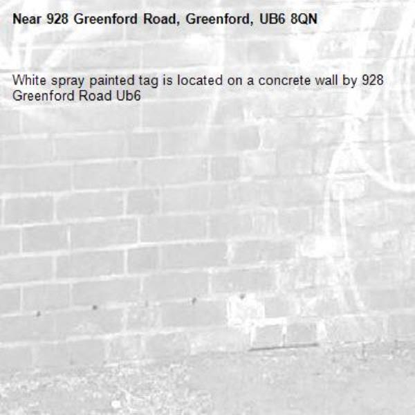 White spray painted tag is located on a concrete wall by 928 Greenford Road Ub6 -928 Greenford Road, Greenford, UB6 8QN