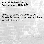 These red sacks are used by our Streets Team and have been left there for collection shortly.-34 Totland Close, Farnborough, GU14 8TX