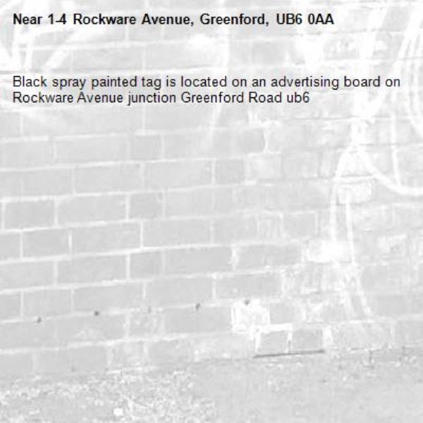 Black spray painted tag is located on an advertising board on Rockware Avenue junction Greenford Road ub6 -1-4 Rockware Avenue, Greenford, UB6 0AA