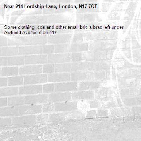 Some clothing, cds and other small bric a brac left under Awfueld Avenue sign n17-214 Lordship Lane, London, N17 7QT