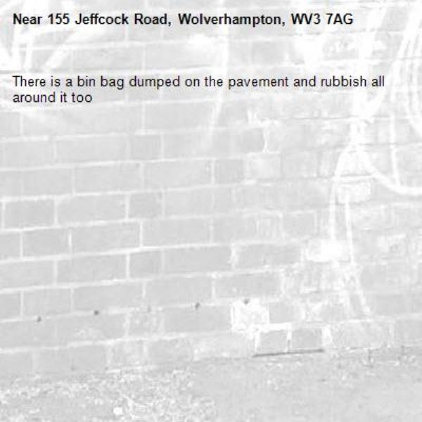 There is a bin bag dumped on the pavement and rubbish all around it too -155 Jeffcock Road, Wolverhampton, WV3 7AG