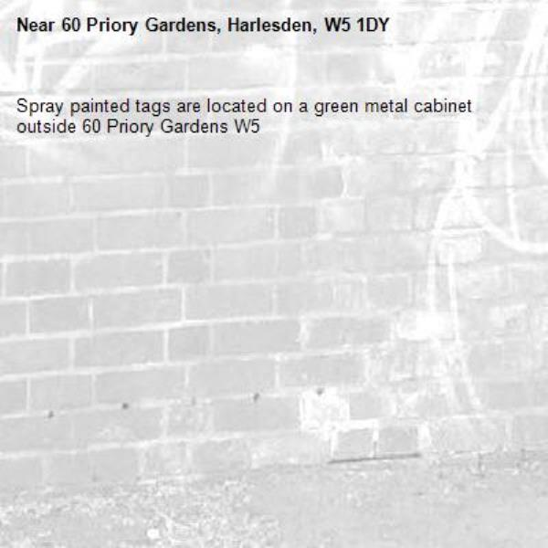 Spray painted tags are located on a green metal cabinet outside 60 Priory Gardens W5-60 Priory Gardens, Harlesden, W5 1DY