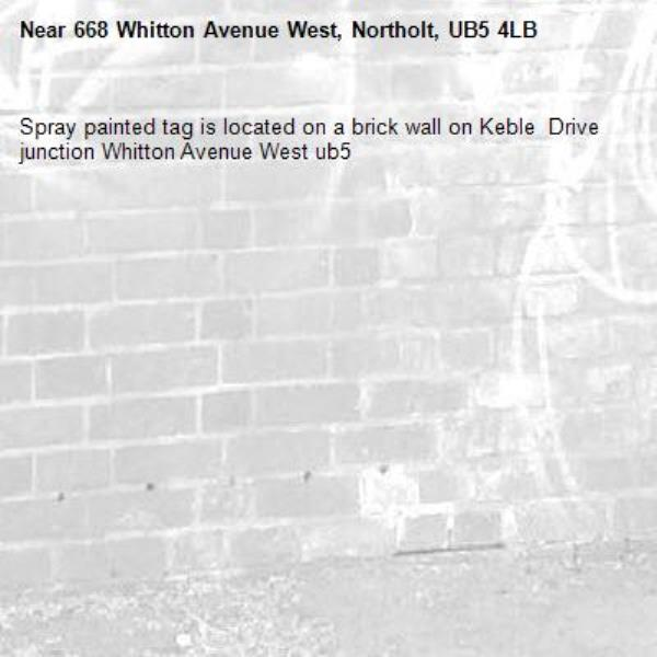 Spray painted tag is located on a brick wall on Keble  Drive junction Whitton Avenue West ub5-668 Whitton Avenue West, Northolt, UB5 4LB