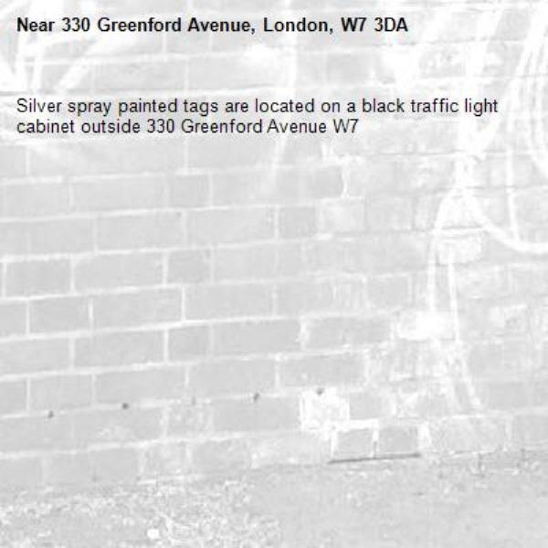 Silver spray painted tags are located on a black traffic light cabinet outside 330 Greenford Avenue W7 -330 Greenford Avenue, London, W7 3DA
