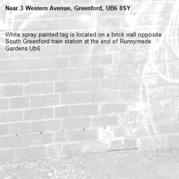 White spray painted tag is located on a brick wall opposite South Greenford train station at the end of Runnymede Gardens Ub6 -3 Western Avenue, Greenford, UB6 8SY