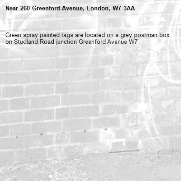 Green spray painted tags are located on a grey postman box on Studland Road junction Greenford Avenue W7 -260 Greenford Avenue, London, W7 3AA